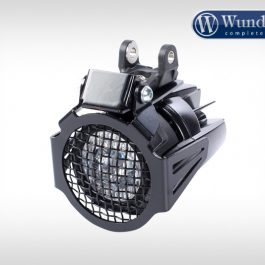 Auxiliary light protection grill